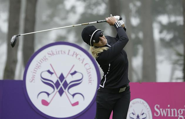 Natalie Gulbis follows her drive from the second tee of the Lake Merced Golf Club during the first round of the Swinging Skirts LPGA Classic golf tournament Thursday, April 24, 2014, in Daly City, Cal
