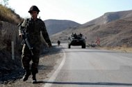 Turkish soldiers patrol a highway near Hakkari close to the border with Iraq. Kurdish rebels stormed a Turkish army post on the Iraq border Sunday, triggering fighting that killed 22 people in the latest clash since Ankara launched a major offensive against the outlawed PKK