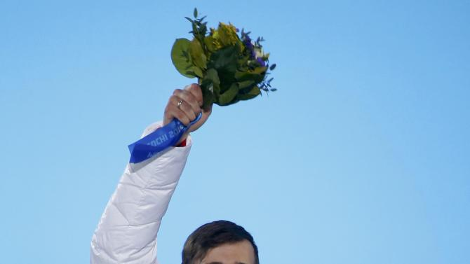 Gold medallist Tretiakov of Russia celebrates during the victory ceremony for the men's skeleton event at the 2014 Sochi Winter Olympics in Sochi