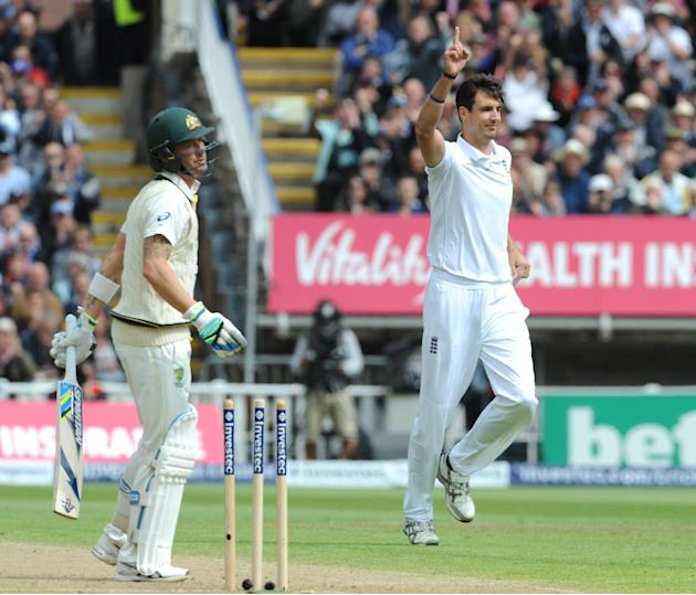 England's Steven Finn, right, celebrates after bowling Australia's Michael Clarke, left, for 10 runs during day one of the third Ashes Test cricket match, at Edgbaston, Birmingham, England, Wednesday,