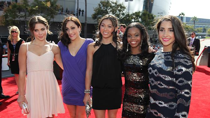 U.S. gymnasts, from left, McKayla Maroney, Jordyn Wieber, Kyla Ross, Gabrielle Douglas and Alexandra Raisman arrive at the MTV Video Music Awards on Thursday, Sept. 6, 2012, in Los Angeles. (Photo by Matt Sayles/Invision/AP)