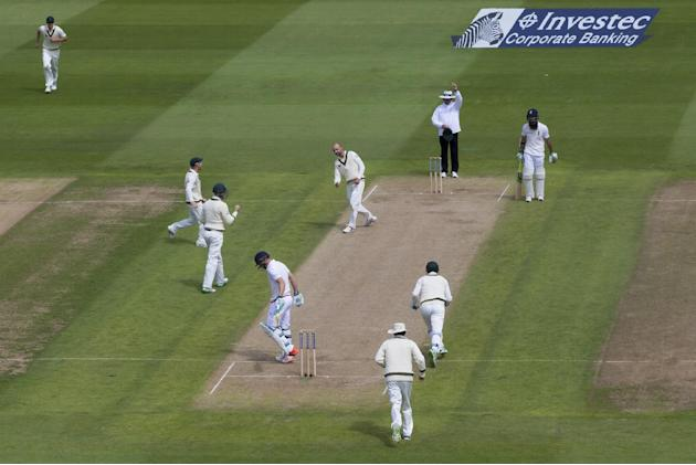 Australia's Nathan Lyon, centre, celebrates taking the wicket of England's Jos Buttler, bottom left, LBW for 9 on the second day of the third Test match of the five match series between Englan