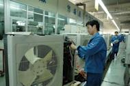 Workers make appliances at the Haier factory in Qingdao, in northeast China's Shandong province in June 2012. Chinese appliance and electronics giant Haier is aiming to expand into Europe with higher-end products, helping to upgrade China's reputation for churning out mostly cheap, low-quality goods