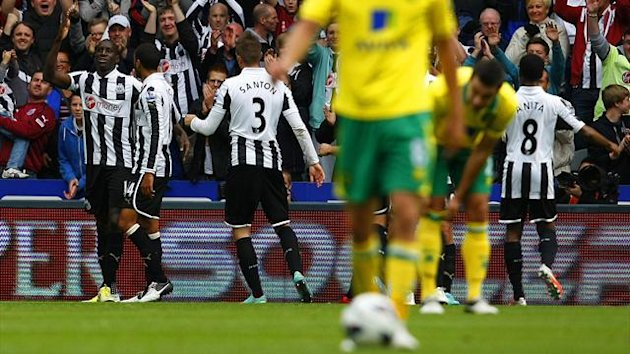 Newcastle United's Demba Ba celebrates with teammates after scoring against Norwich City during their Premier League