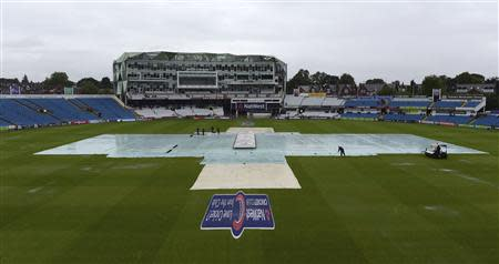 TThe covers are on the pitch as rain delayed the start of the first one-day international between England and Australia at Headingley cricket ground