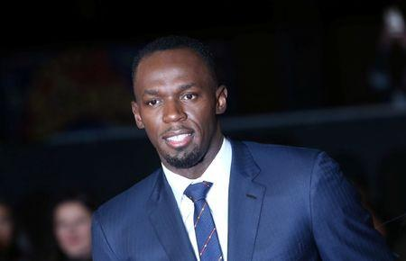 "Athlete Usain Bolt (C) poses for photographers at the world premiere of the film ""I am Bolt"" in London"