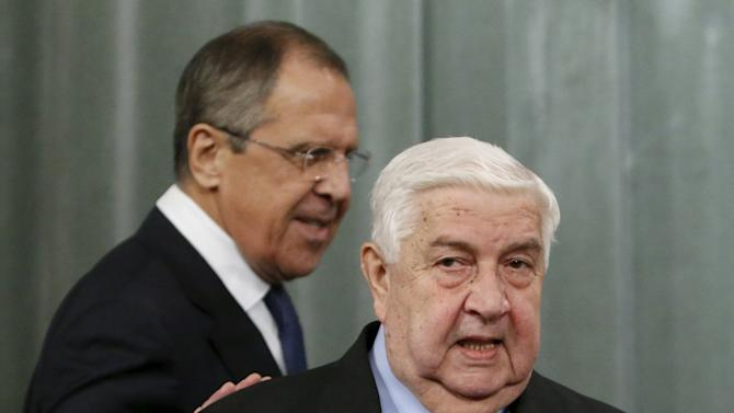 Russia's Foreign Minister Sergei Lavrov and his Syrian counterpart Walid al-Moualem attend a news conference in Moscow