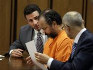 Ariel Castro, center, confers with his attorneys Craig Weintraub, left, and Jaye Schlachet during a pretrial hearing in Cuyahoga County Common Pleas Court in Cleveland, Wednesday, July 3, 2013. Castro is accused of holding three women captive for nearly a decade. (AP Photo/Mark Duncan)