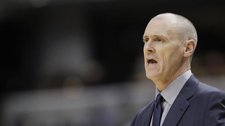 Dallas Mavericks coach Rick Carlisle talks to his players from the sidelines during the second half of an NBA preseason basketball game against the Indiana Pacers in Indianapolis, Wednesday, Oct. 16, 2013. The Mavericks won 92-85