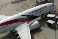 A Malaysian Airlines aircraft at Kuala Lumpur airport on Tuesday. The struggling flag carrier says it has swung back to a profit after six straight quarterly losses as the slashing of unprofitable routes helped cut costs