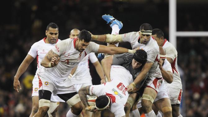 Wales' Jones tackles Tonga's T-Pole during their international rugby union match in Cardiff