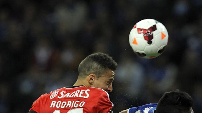 FC Porto's Alex Sandro, right, from Brazil challenges for a high ball with Benfica's Rodrigo Machado, from Spain, in a Portugal Cup Semi-final, first leg soccer match at the Dragao stadium in Porto, Portugal, Wednesday, March 26, 2014