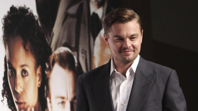 "FILE - In this March 2, 2013 file photo, actor Leonardo DiCaprio poses for a photo call during a press conference to promote his new film ""DJango Unchained"" in Tokyo. Quentin Tarantino's violent slave-revenge movie ""Django Unchained"" returned to Chinese theaters on Sunday, May 12, 2013 about a month after it was pulled on opening day for unspecified ""technical reasons."" (AP Photo/Junji Kurokawa, File)"