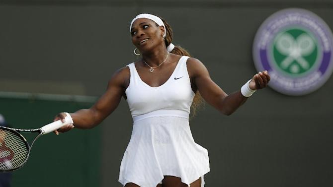 Serena Williams of U.S. gestures during the women's singles match against Alize Cornet of France at the All England Lawn Tennis Championships in Wimbledon, London, Saturday, June 28, 2014