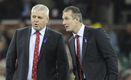 Wales' Head Coach Warren Gatland speaks with Assistant Coach Rob Howley before their international rugby union match against Argentina at the Millennium Stadium in Cardiff