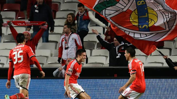 Benfica's Nico Gaitan, from Argentina, center, celebrates after scoring the opening goal during their Portuguese league soccer match with Sporting Tuesday, Feb. 11, 2014, at Benfica's Luz stadium in Lisbon