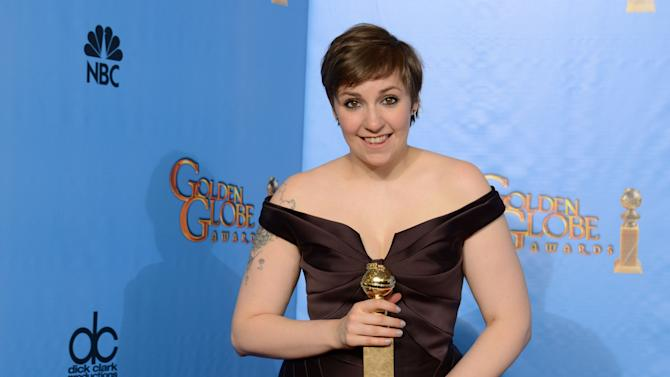 "Actress, writer and director Lena Dunham poses with the award for best television series - comedy or musical for ""Girls"" backstage at the 70th Annual Golden Globe Awards at the Beverly Hilton Hotel on Sunday Jan. 13, 2013, in Beverly Hills, Calif. (Photo by Jordan Strauss/Invision/AP)"