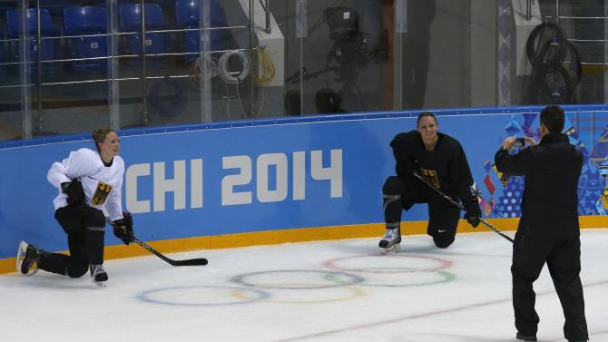 Players from the German Women's Ice Hockey team pose for a picture after a training session at the Shayba Arena in preparation for the 2014 Sochi Winter Olympics