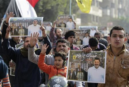 "Supporters of the Muslim Brotherhood and ousted Egyptian President Mohamed Mursi protest against the military and interior ministry, while making the four-finger Rabaa gesture, at Nasr City district in Cairo January 3, 2014. The ""Rabaa"" or ""four"" gesture is in reference to the police clearing of the Rabaa al-Adawiya protest camp on August 14, 2013. REUTERS/ Mohamed Abd El Ghany"
