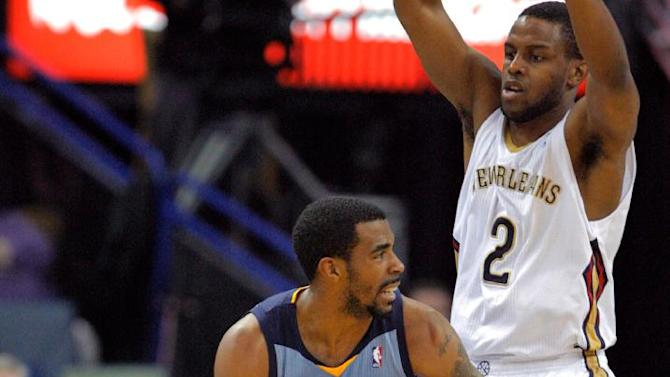 Memphis Grizzlies guard Mike Conley (11) dribbles around New Orleans Pelicans forward Darius Miller (2) in the second half of an NBA basketball game in New Orleans, Wednesday, March 12, 2014. The Grizzlies won 90-88 on a last-second shot by Conley