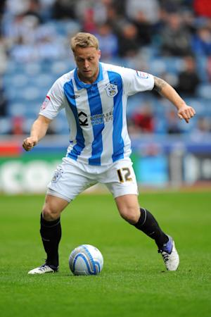 Tom Clarke made his Huddersfield debut in 2006