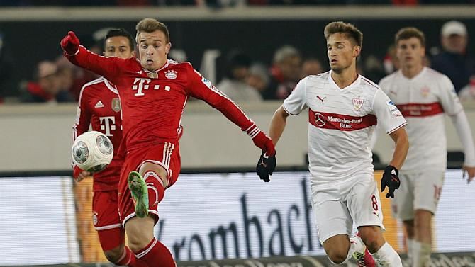 Stuttgart's Moritz Leitner, right, and Bayern's Xherdan Shaqiri of Switzerland challenge for the ball during a German first soccer division Bundesliga match between VfB Stuttgart and FC Bayern Munich in Stuttgart, Germany, Wednesday, Jan. 29, 2014