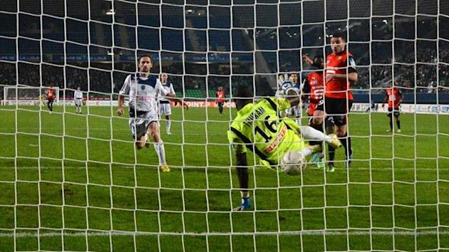 Rennes forward Romain Alessandrini scores past Troyes goalkeeper Yohann Thuram in the Coupe de la Ligue (AFP)