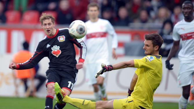 Leverkusen's Stefan Kiessling , left,  scores against Stuttgart's Sven Ulreich during the Bundesliga soccer match between Bayer Leverkusen and VfB Stuttgart at BayArena in Leverkusen, Germany,  Saturday Feb. 1,  2014