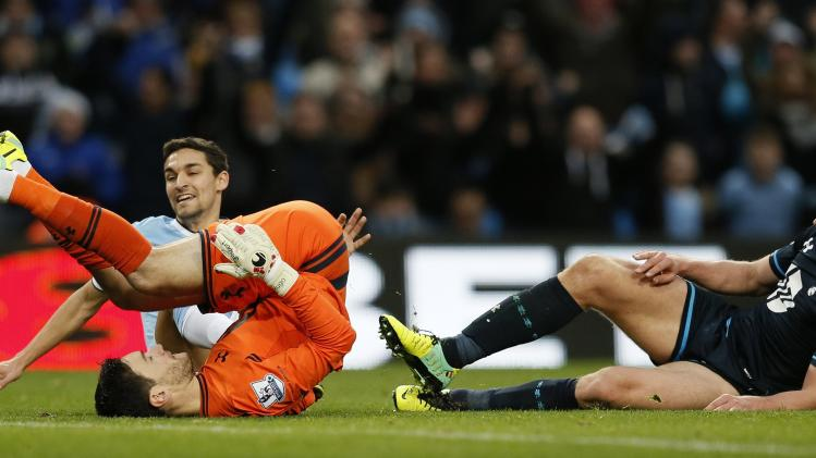 Manchester City's Jesus Navas celebrates after scoring his second goal past Tottenham Hotspur goalkeeper Hugo Lloris during their English Premier League soccer match against Tottenham Hotspur at the Etihad Stadium in Manchester