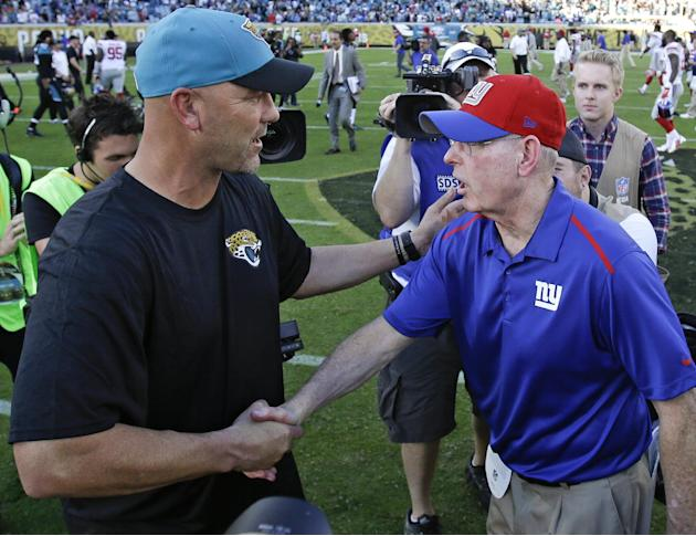 Jacksonville Jaguars head coach Gus Bradley, left, and New York Giants head coach Tom Coughlin shake hands after an NFL football game in Jacksonville, Fla., Sunday, Nov. 30, 2014. Jacksonville won 25-