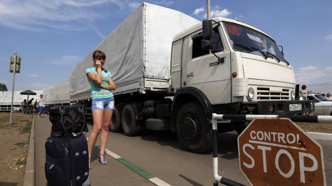 "Trucks of a Russian convoy carrying humanitarian aid for Ukraine drive onto the territory of a Russia-Ukraine border crossing point ""Donetsk"" in Rostov Region"