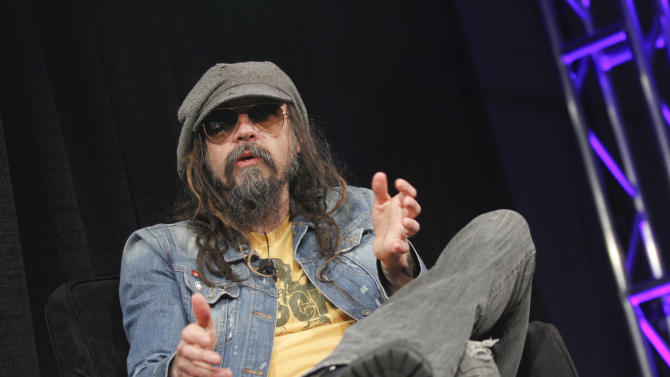 """FILE - This March 12, 2013 file photo shows musician-actor Rob Zombie talking about his new film """"Lords of Salem"""" at the SXSW Film Festival in Austin, Texas. Zombie released his fifth studio album, """"Venomous Rat Regeneration Vendor,""""  last month, and he plans to support the record with a summer tour of the states, and an appearance at the Rock in Rio Festival in Brazil. (Photo by Jack Plunkett/Invision/AP, file)"""
