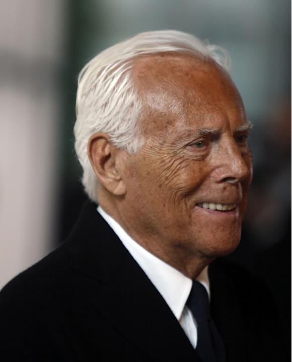 Giorgio Armani smiles as he arrives for an exclusive fashion show in Milan, Italy, Thursday, April 30, 2015. The Milan Expo 2015 world's fair has some heady ambitions: devise a plan to feed the pl
