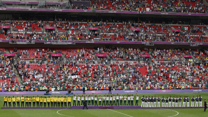 Silver medallists Brazil, gold medallists Mexico and bronze medallists South Korea stand on the medal podiums during the soccer medal award ceremony  at Wembley Stadium during the London 2012 Olympic Games