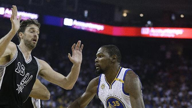 Golden State Warriors' Kevin Durant, right, drives the ball against San Antonio Spurs' Pau Gasol during the first half of an NBA basketball game Tuesday, Oct. 25, 2016, in Oakland, Calif. (AP Photo/Ben Margot)