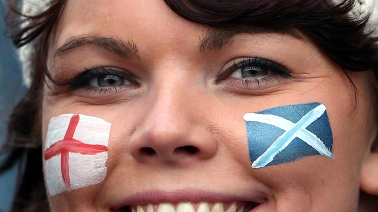 A rugby fan displays her face painted with the flags of Scotland and England ahead of the Six Nations rugby union international match between Scotland and England at Murrayfield, Edinburgh, Scotland, Saturday Feb. 8, 2014