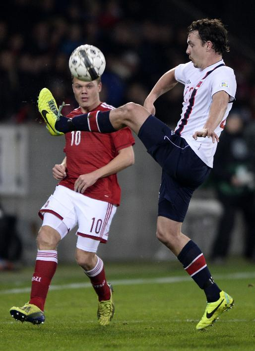 Norway's Vegard Forren, right, tries to keep the ball from Denmark's Emil Larsen during their international friendly match in Herning, Denmark, Friday, Nov. 15. 2013