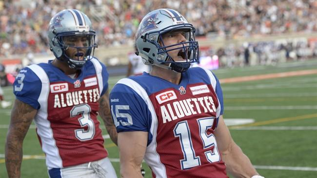 Montreal Alouettes wide receiver Samuel Giguere (15) celebrates his touchdown against the Calgary Stampeders with teammate Cody Hoffman (3) during first half CFL football action in Montreal, Friday July 3, 2015. THE CANADIAN PRESS/Ryan Remiorz