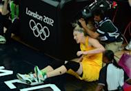 Australian centre Lauren Jackson falls to the ground during the London 2012 Olympic Games women's bronze medal basketball game between Australia and Russia at the North Greenwich Arena in London. Jackson scored 25 points and grabbed 11 rebounds to lead Australia to a women's basketball medal for the fifth Olympics in a row as the Opals beat Russia 83-74 in the bronze-medal game