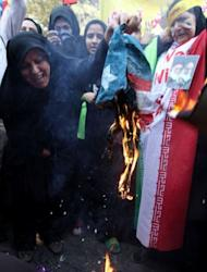"Iranian demonstrators burn a US flag outside the former US embassy in Tehran. Thousands of Iranians chanting ""Death to America"" burnt US flags to mark the 33rd anniversary of the seizure of the US embassy in Tehran"