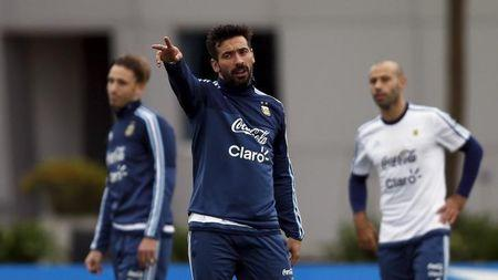 Argentina's Lavezzi gestures next to teammates Mascherano and Biglia during a training session ahead of their 2018 World Cup qualifying soccer match against Brazil in Buenos Aires