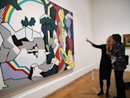 "Co-curator Sheena Wagstaff(L) of London's Tate Modern describes Pop art icon Roy Lichtenstein's ""Frolic"" on May 11. The exhibit runs through September 3 at the Art Institute of Chicago"