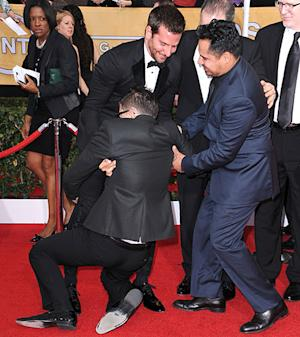 Bradley Cooper Surprised By Notorious Prankster Vitalii Sediuk's Crotch Hug: Pictures