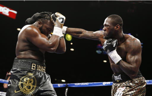 Deontay Wilder hits Bermane Stiverne during their WBC heavyweight title bout Saturday, Jan. 17, 2015, in Las Vegas. (AP Photo/John Locher)
