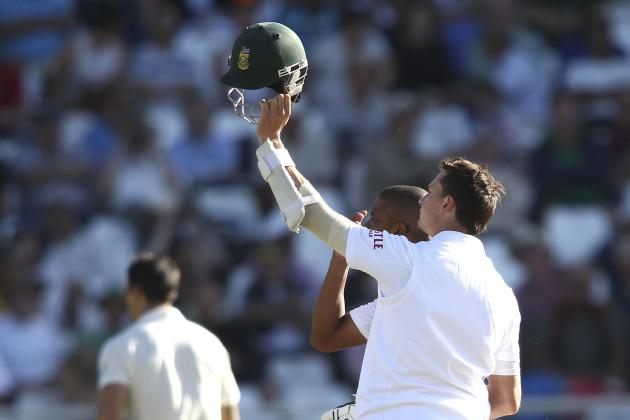 South Africa's Steyn calls for a new helmet after being hit on the head by a Johnson delivery during the third day of the third cricket test match against Australia at Newlands Stadium in Cape Tow