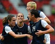 United States's forward Abby Wambach (R) celebrates with teammates after scoring during the London 2012 Olympic Games women's football match between USA and North Korea at Old Trafford in Manchester, north-west England on July 31, 2012. AFP PHOTO / ANDREW YATES