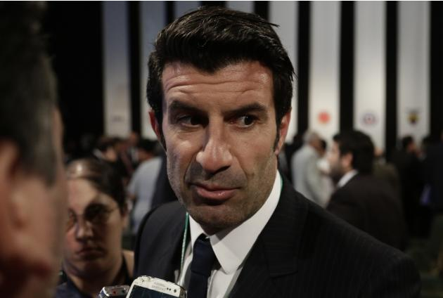 Portugal's Figo talks to reporters after attending the CONMEBOL general congress in Asuncion, Paraguay, Wednesday, March 4, 2015. The former Portugal, Barcelona and Real Madrid playmaker entered F