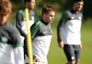 Celtic's James Forrest (C) takes part in a training session at Lennoxtown training facility near Glasgow, Scotland, on September 18, 2012. Forrest says he is desperate to prove his fitness and play his part in helping the Parkhead side with their hectic festive schedule as they face Ross County next, on Saturday