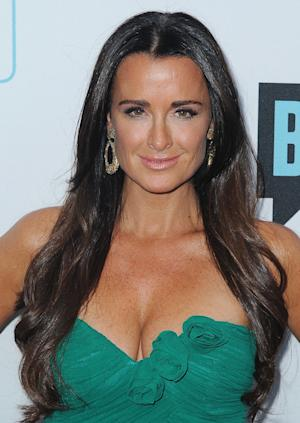 """FILE - In this March 30, 2011 file photo, TV personality Kyle Richards arrives at the Bravo Media's 2011 upfront presentation at The Roosevelt Hotel in Los Angeles. """"The Real Housewives of Beverly Hills"""" star, mother of four girls and wife of 17 years doles out her brand of no nonsense advice on relationships, fashion and beauty in her new book, """"Life Is Not a Reality Show: Keeping It Real with the Housewife Who Does It All."""" (AP Photo/Katy Winn, file)"""