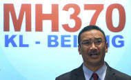 "Malaysian acting Transport Minister Hishammuddin Hussein speaks during a press conference at a hotel in Sepang, Malaysia, Thursday, March 20, 2014. Military search planes flew over a remote part of the Indian Ocean on Thursday hunting for debris in ""probably the best lead"" so far in finding the missing Malaysia Airlines flight, officials said. (AP Photo) MALAYSIA OUT"
